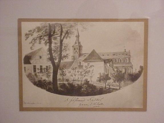 Odense, set fra syd. I midten ses Sct. Knuds Kirke. Til højre ses Vor Frue Kirke. I forgrunden til højre ses Nonnebakken. Farvelagt træsnit ca. 1820 udført af R.N. Nielsen.